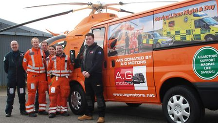 Aaron Ginn, right, with the Magpas Helimedix team, air ambulance and the new look Magpas van