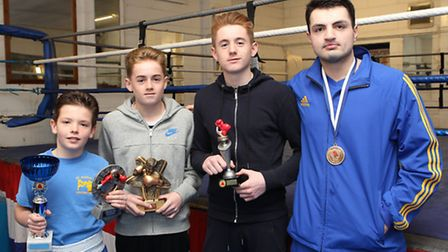St Albans boxing club youngsters John Stanley, 11, Finn, 12, Liam Murphy, 15 and Anees Taj with thei