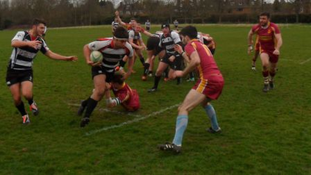 Action from Harpenden's win over Hampstead in London Two North West.