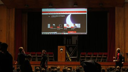 St Columba's College pupils gather in the school's hall to watch a live web cast of the solar eclips