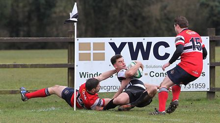Adam Stirling is dragged into touch in the corner