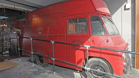 The old Royal Mail post van inside the Jolly Postie