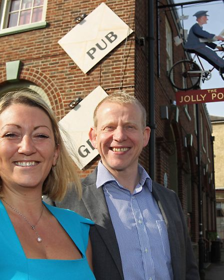 The Jolly Postie manager Laura Jay and area manager Matt Cotter outside the newly refitted pub