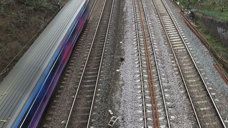 A man was saved from jumping onto a rail line