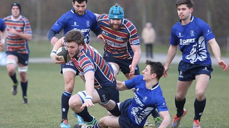 Sam Lunnon goes down under a tackle