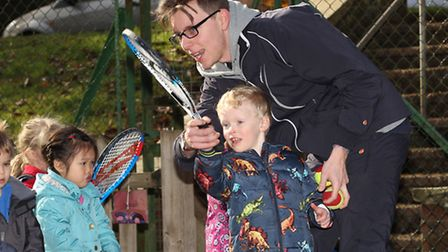 Batchwood tennis academy coach Alex Gooding coaches children during a tennis taster session at Busy