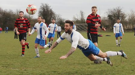 Martin Standen scores Nicholas Breakspear's fifth goal with a flying header against AFC Rangers.