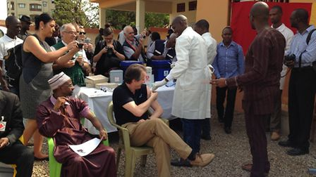 Professor Miles Carroll is given a vaccination against Ebola.