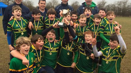 The Huntingdon Stags Under 12 team celebrate their Cambridgeshire County Cup win.