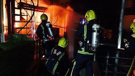 Firefighters tackle houseboat blaze at Hartford Marina. Picture: Cambs Fire