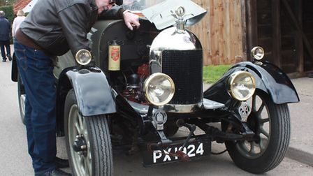 Photos by Clive Porter. Alan Payne from Foxton inspects the engine of his 1924 Bullnose Morris, clas