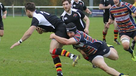 Max Wilkins hangs on to a tackle