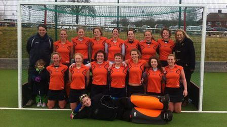 St Albans Hockey Club's Ladies' 2nds with coach Dick Ashby and mascot Darcy. Back row L-R: Dick As
