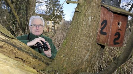 Ian Jackson with one of the bird boxes on Holt Island waiting to be sponsored. Picture: HELEN DRAKE