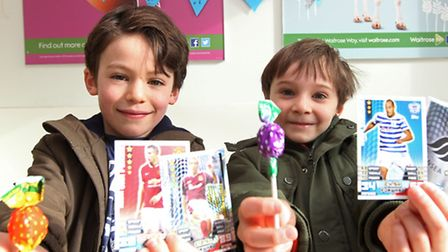 Jacob Finer, 6 and friend Alex Zappone, 7 are selling football cards and lollies to raise money for