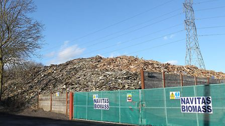 The huge pile of wood on Appspond Lane remains despite intervention from the Environment Agency