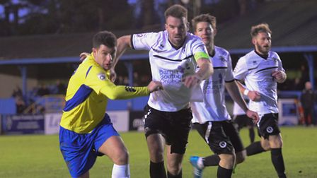 John Frendo and ex-team-mate Ben Martin challenge for the ball. Picture: Bob Walkley