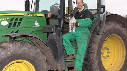 Local farmer Bill Barr with his dog Digby is happy that the government have raised the legal speed l