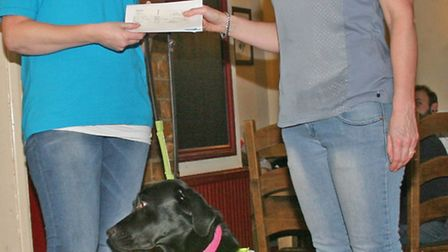 The Black Bull at Brampton raised £5,100 to name a Guide Dog puppy, (l-r) Guide Dog Owner Claire Wal