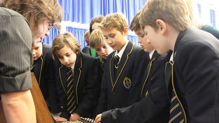Students with the Enigma machine