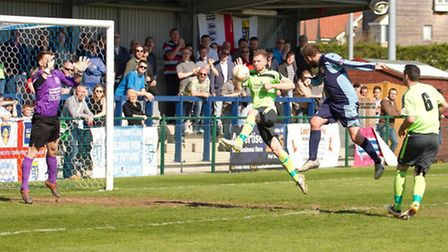 Lee Clarke scores the opening goal for St Neots Town in their 3-0 win over Chippenham. Picture by Cl
