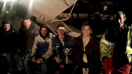 Huntingdon racer Guy Jolly pictured with members of his team after winning the V8 Hotstox Northern a