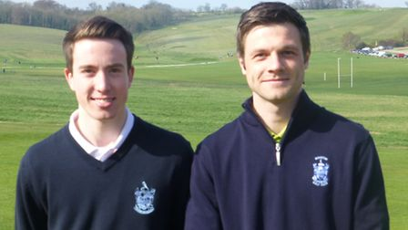 Luke (left) and Ryan Wingate provide help for budding golfers at Royston Golf Club