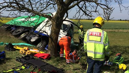The lorry on its side off the A428. Picture: CAMBS FIRE AND RESCUE SERVICE