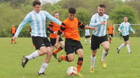 Brookmans Park's Calum Baylis is chased by two Wheathampstead '89 defenders
