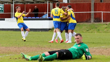 The players celebrate with John Frendo after scoring the Saints' last goal of the season as Hayes ke