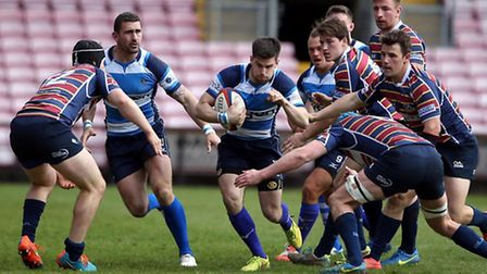 Mowden's Cameron Henry Robinson tries to evade Old Albanian tacklers. Picture: Chris Booth