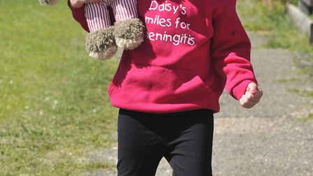 Four-year-old Daisy Bell who is doing a charity walk to fundraise for meningitis charities.