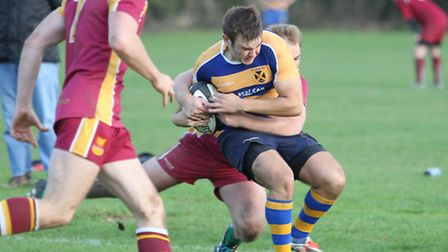 Daniel Townson gets tackled into touch