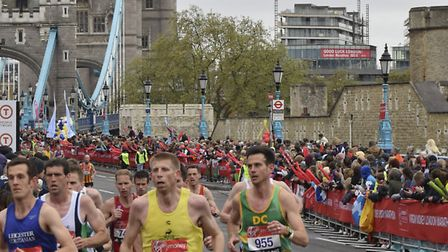 Dave Connell of Hunts AC (right) in action in the London Marathon.