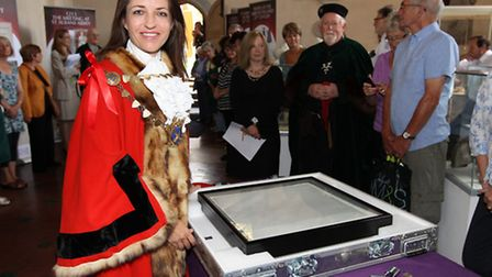 Former Mayor of St Albans Cllr Annie Brewster with the Magna Carta during its visit to the city