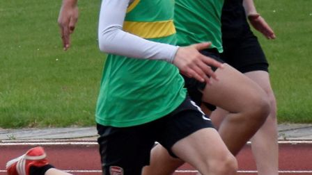 Joe Purbrick winning the Under 13 Boys 100m title in the first of the Hunts AC club championship mee