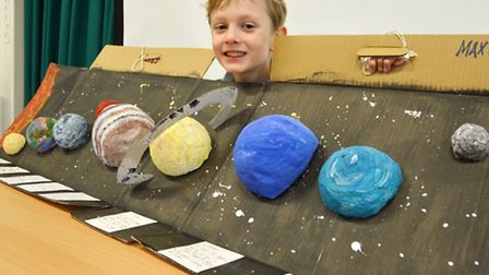 Max 9 with his solar system model