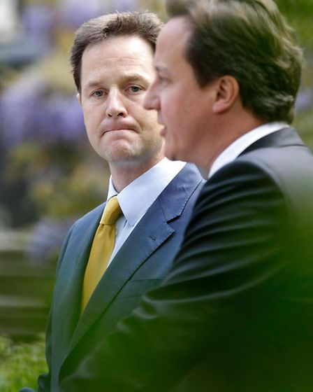 Prime Minister David Cameron (right) and Deputy Prime Minister Nick Clegg hold their first joint pre