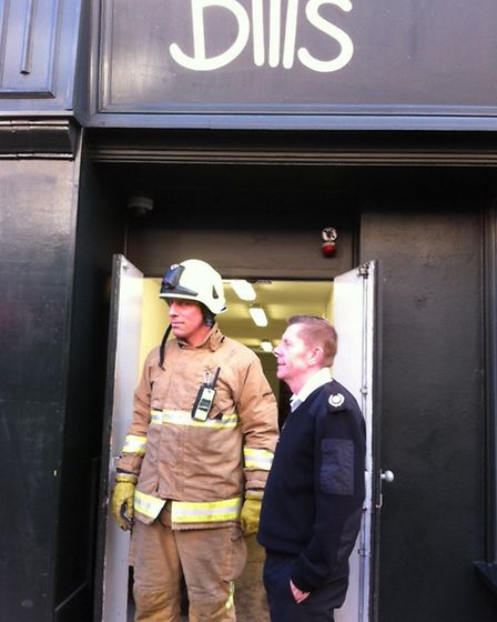 Firefighters from St Albans Fire Station check the source of smoke at Bill's Restaurant in St Albans