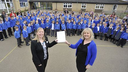 St Helen's deputy head Emma Smith and executive head Judith Branch celebrate a good Ofted with pupil