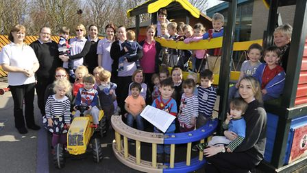 Pupils and staff at Roundabout Nursery, St Ives, celebrate receiving an outstanding Ofsted rating.