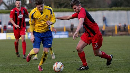 Elliot Bailey tries to power past Warren Daw. Picture: Leigh Page
