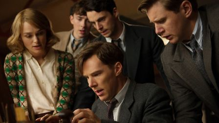 The Bletchley Park codebreakers pore over an Enigma machine