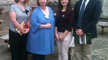 Photograph shows left to right: Tamsin Page (English teacher) Hilary Mantel, Lottie May (senior stud