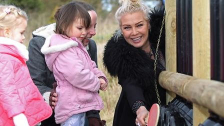 Local pop star Kim Wilde plays with local children on some of the instruments made from recycled mat