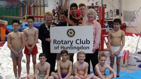 Huntingdon Gym Club youngsters with members of Huntingdon Rotary club.