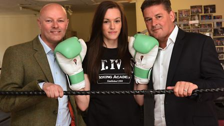 St Ives boxing star Shona Whitwell pictured with sponsors Aran McNish of Opalbond (left) and Stuart
