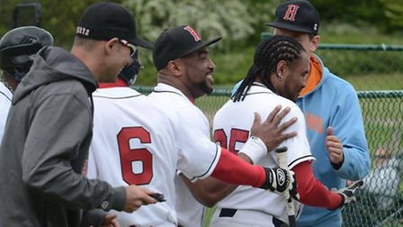 Jose Sosa is mobbed by his team-mates after his home run. Picture: Paul Holdrick