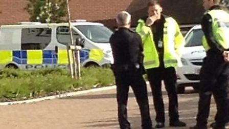 Police awaiting the bomb disposal team.