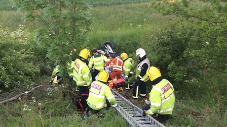 Fire crews and medics rescue a motorcyclist from a ditch by the A428 near St Neots. Picture: CAMBS F